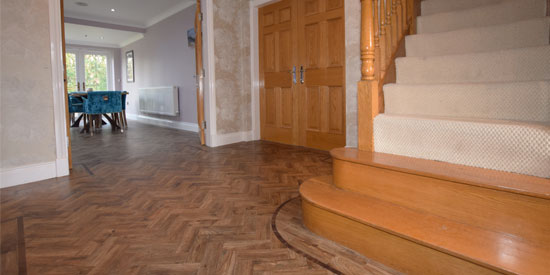 Installation of LVT herringbone Parquet Flooring in Bolton