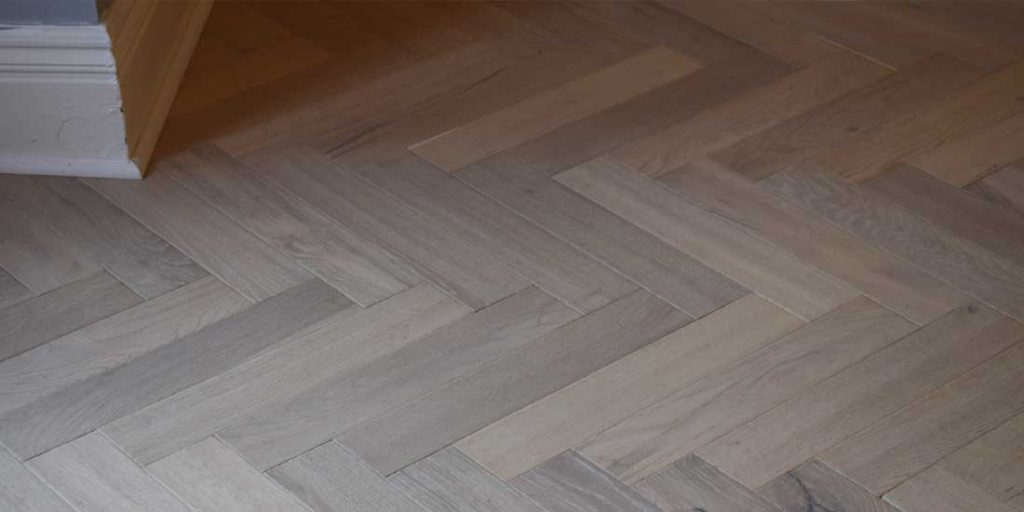 Installation of Ted Todd Raw Cotton Herringbone Parquet