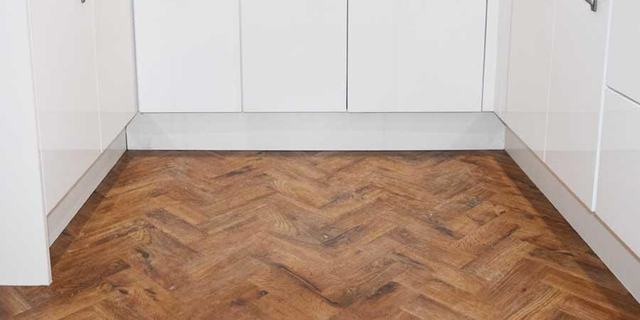 installation of herringbone parquet flooring in Altrincham