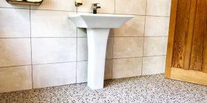 Installation of Bathroom Flooring in Manchester City Centre