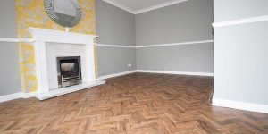 Installation of Polyflor luxury vinyl parquet flooring in Chorlton
