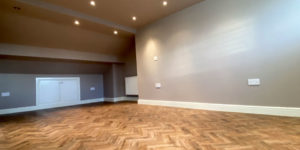 Installation of Polyflor Georgian Oak parquet flooring in Northenden, M22