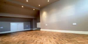 Installation of Polyflor Georgian Oak parquet flooring in Northenden, M22