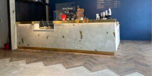 Commercial Installation of Amtico Spacia Noble Oak Parquet flooring in Stalybridge