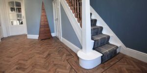 Installation of Polyflor Georgian Oak parquet flooring in Chorlton