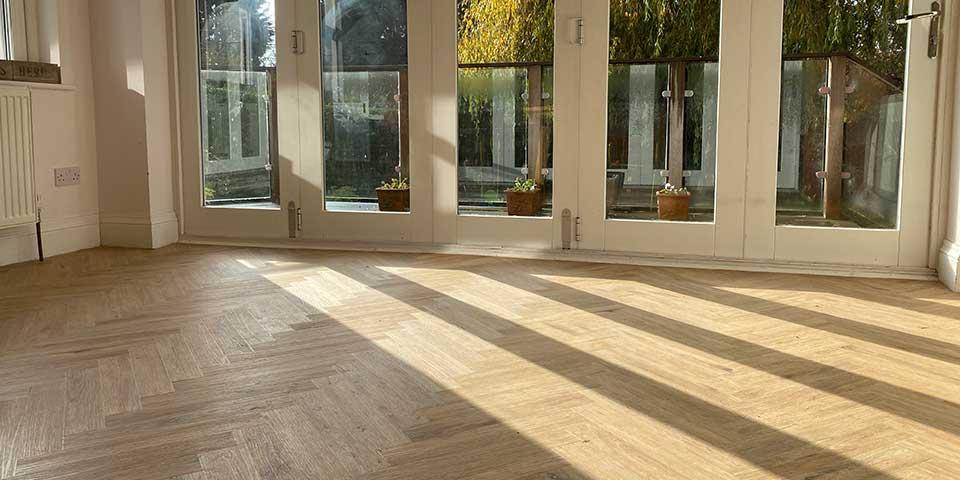 Installation of Project Floors Silvered Oak Herringbone flooring installation in Davenport SK2